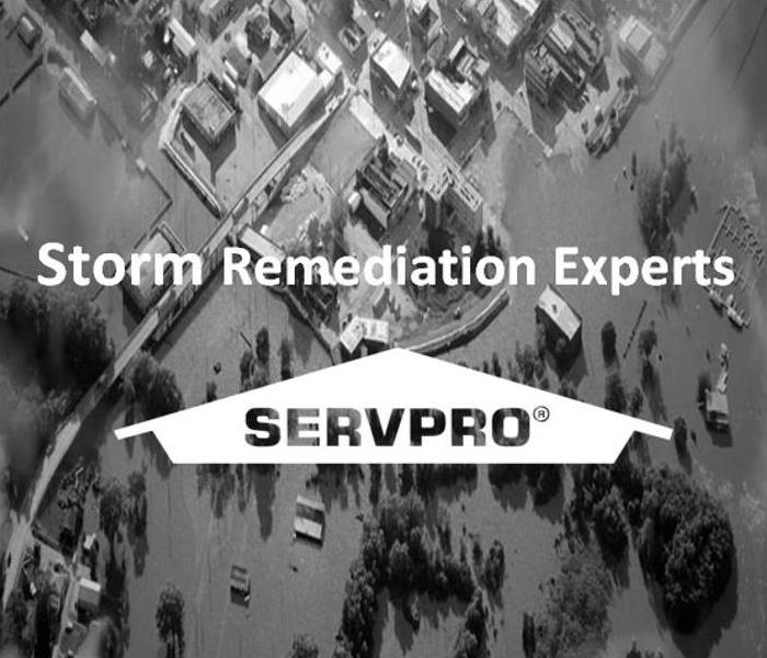 Image of flooded town with SERVPRO Logo and text, Storm Remediation Experts