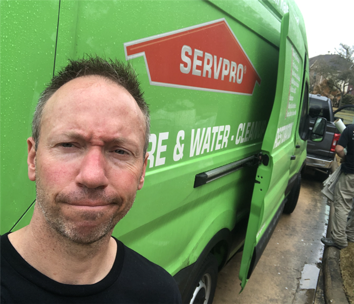 man in front of green van